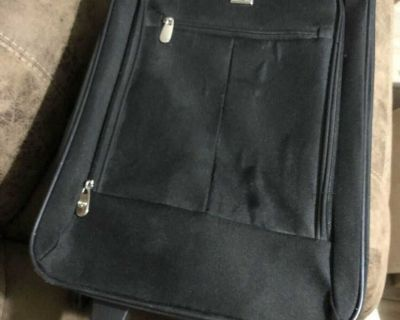 Black Rolling Smaller Suitcase 20 tall 6 1/2 by 12 1/2 wide - Wheels & Zippers work well