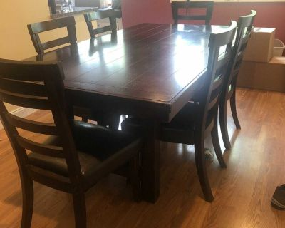 Large wood table with 6 chairs and sideboard /buffet
