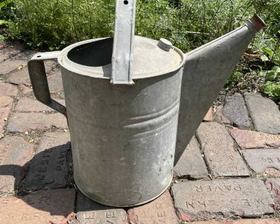 Galvanized water can