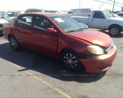 Salvage Red 2003 Toyota Corolla