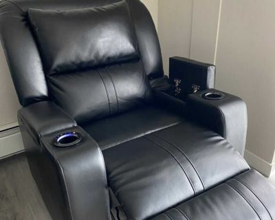 Leather fabric accent power recliner.