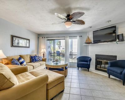 Enjoy this updated townhome with views of the gulf and pool from the deck. - East End