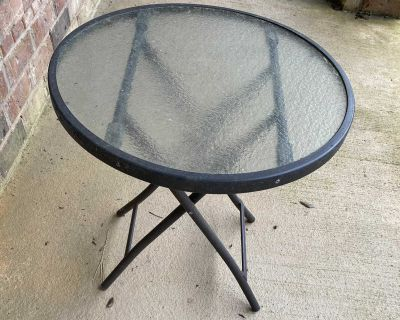 Outdoor glass top table, $8.00