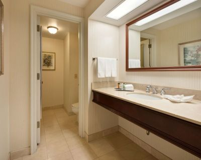 2 Connecting Suites with 2 beds and 1 sofabed at a Full Service Hotel by Suiteness - Westown