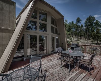 Spend your mountain vacation at Alto Pines, a cozy A-frame home that backs up to - Alto