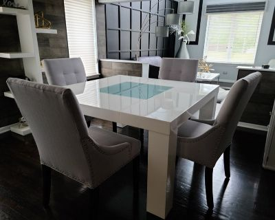 Contemporary White Dining Table and 4 Light Gray Chairs w/silver nail heads.