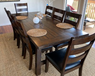Dining table set with 8 leather covered chairs