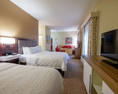 2 Connecting Suites with 3 beds and 2 sofabeds at a Full Service Hotel by Suiteness - Lafayette