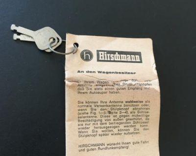 Early porsche antenna keys on original booklet