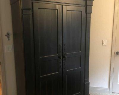Massive black armoire