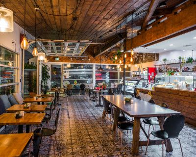 Beautiful modern rustic Cafe with Garage Door and Patio, Los Angeles, CA
