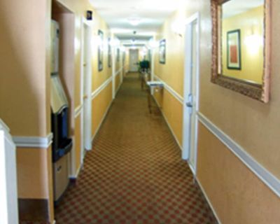 Welcome to the Holland Inn Suites double room with King Bed - Taft