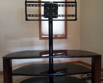 Tv stand, can mount tv or put on stand. Black glass shelves.