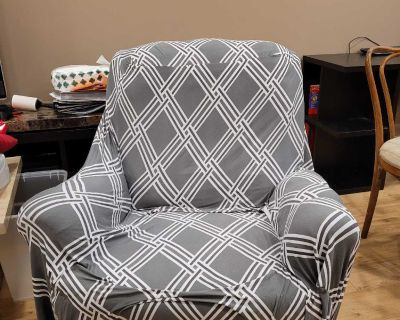 Rocking recliner with slip cover