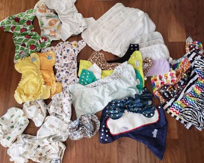 23 cloth diapers, 15 liners plus more