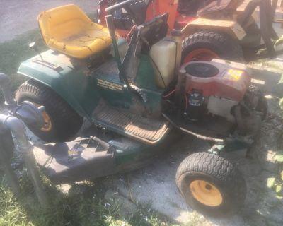 yard man riding mower