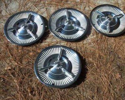 Accessories - Pontiac: 1957 Pontiac Bonneville Hubcaps