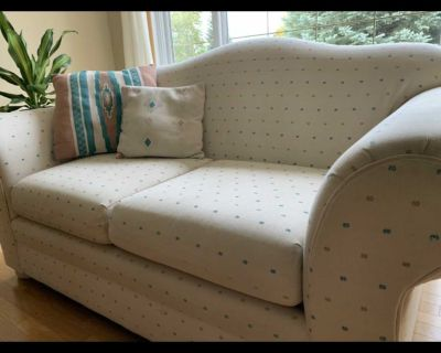 Love seat with cushions
