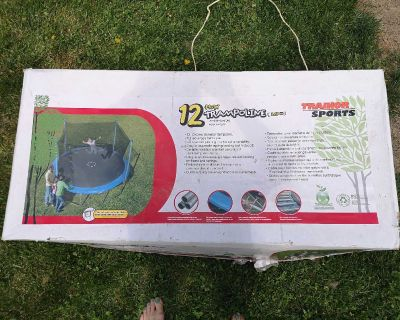 New Trainor Sports 12' trampoline with enclosure for sale.