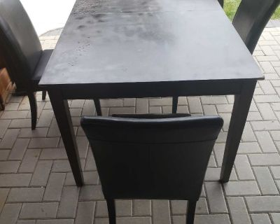 Sturdy dining room table four chairs and extension board