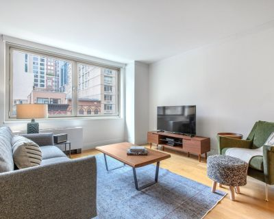 Bright UES 1BR w/ Gym, Rooftop, Doorman, near The MET, by Blueground - Upper East Side