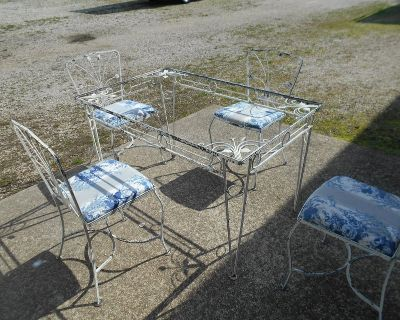 out door metal table and 4 chairs