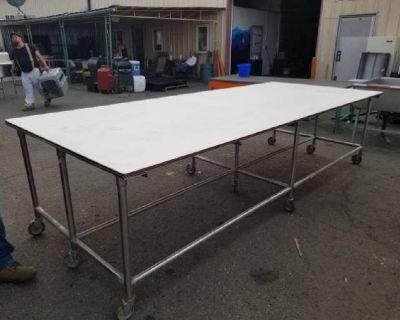 5' x 12' bakery or work table on stainless steel frame with casters