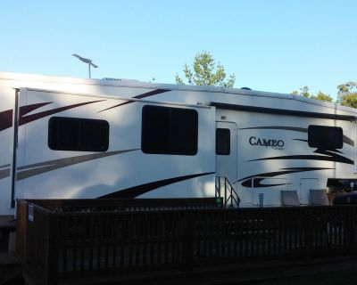 2007 35' CAMEO BY CARRIAGE 5TH WHEEL CAMPER, 11X29 DECK, AND 12X16 SHED