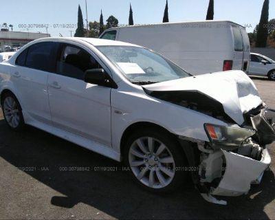 Salvage White 2011 Mitsubishi Lancer