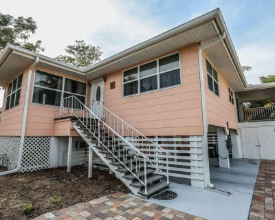 Open and airy, comfortable, private, and proximity to the beach best describes this 2 bedroom, 2 bath stilt home located mid-way down the beautiful Estero Island - Mid Island