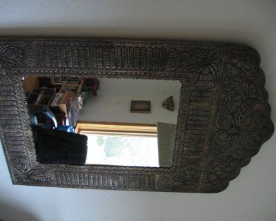 Metal framed distressed accent wall mirror