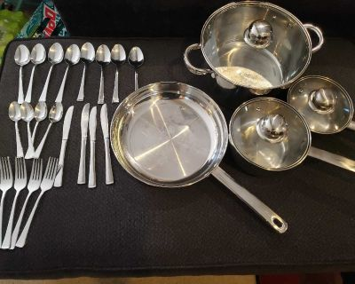 Stainless steel cookware set with 20 pc cutlery