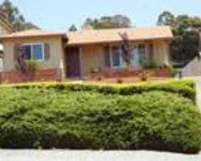 Acreage & Charm Abound in Redwood Heights Vintage Home