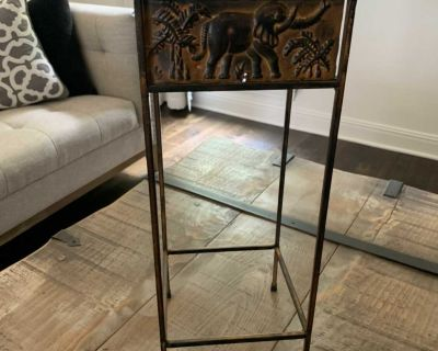 Metal plant stand or small accent table measures approximately 21 x8 x8