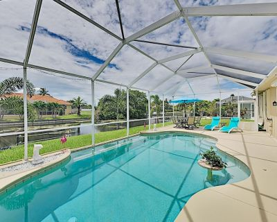 Canal-Front Beauty with Private Heated Pool, Grill & Garage - Cape Coral