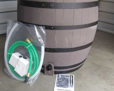 Whiskey barrel rainwater collection system with built in planter