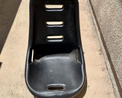 Low back bucket seat with cover.