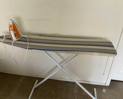Ironing board stand with steam iron