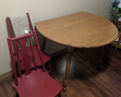Kitchen table with 2 red chairs