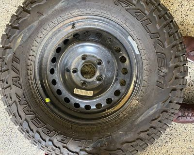 """Texas - 17"""" Rubicon OEM rims and 33"""" Falken tires for Sale"""
