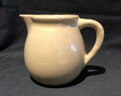 Vintage hand thrown brown pitcher