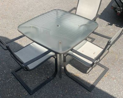 Patio table + 3 chairs