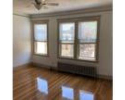 Elegant Tudor Suite, Just Renovated, Large windows fill apartment with Natural