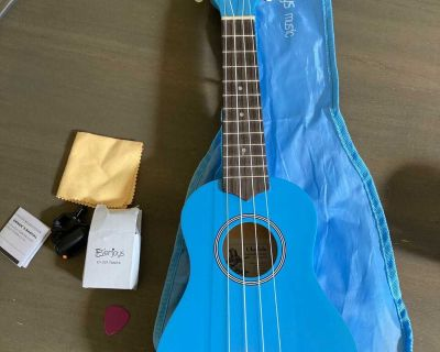 Blue Ukulele with bag, tuner, cloth, and pick