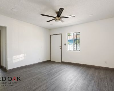 Completely Remodeled Two Bedroom One Bath With Parking Available!! TWO WEEKS FREE!