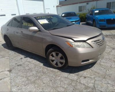 Salvage Gold 2009 Toyota Camry