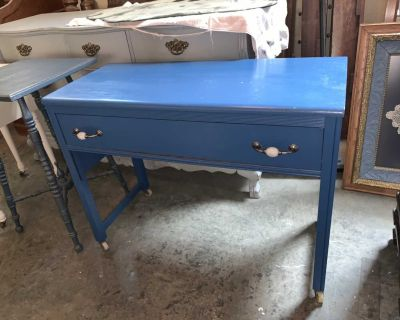 Small blue desk/side table on rollers