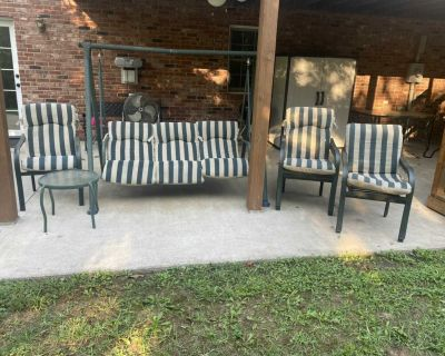 6 Stackable Metal chairs, 1 small table, 1 large table 6 cushions, 1 Glider