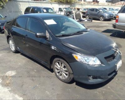 Salvage Black 2010 Toyota Corolla