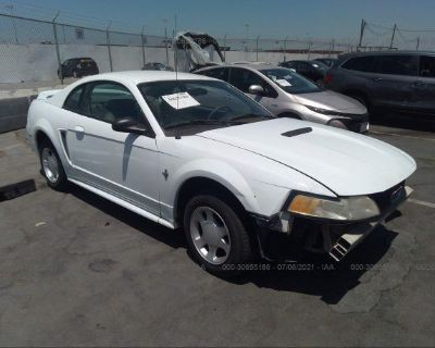 Salvage White 2000 Ford Mustang